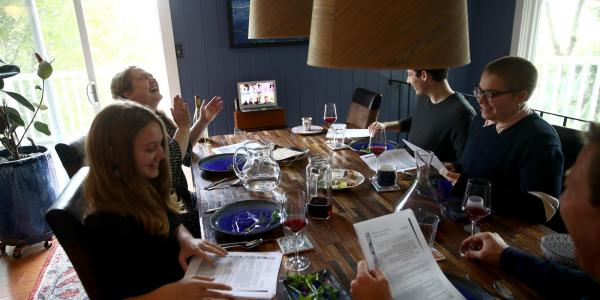 A Jewish family gathers in person and over video conferencing for Passover celebrations in 2020