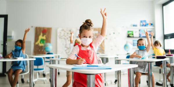 elementary students wearing masks in classroom