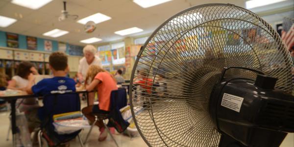 Fan pointed toward students in classroom