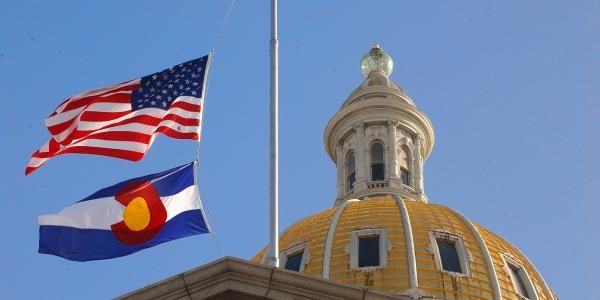 U.S. flag and Colorado state flag