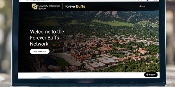 A Forever Buffs Network webpage appears on a laptop screen