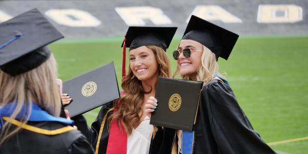 Graduating Buffs pose for a photo on Folsom Field as part of the 2021 Graduation Appreciation Days