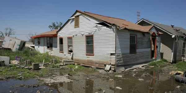 A house in Houston shows visible damage after flooding.