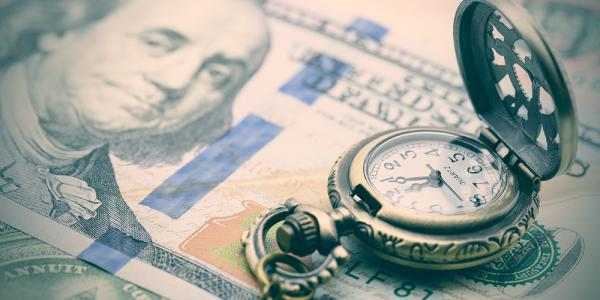 An image of a U.S. 100-dollar bill and a pocket watch