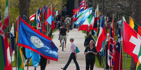 A CU Boulder campus sidewalk with world flags on either side of it