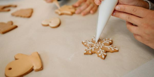 people decorating holiday cookies