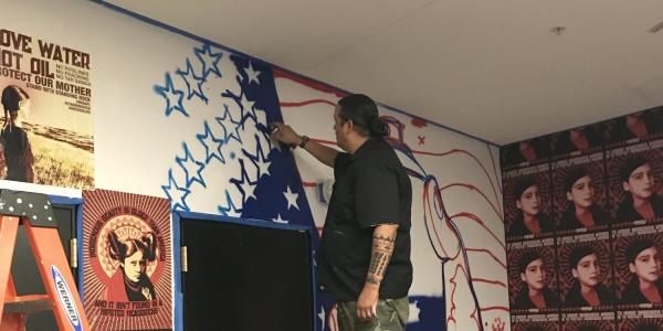 Gregg Deal working on new mural.
