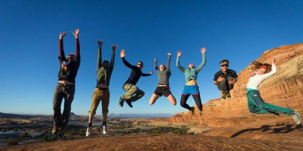 CU's hiking club jumps at the top of a hike