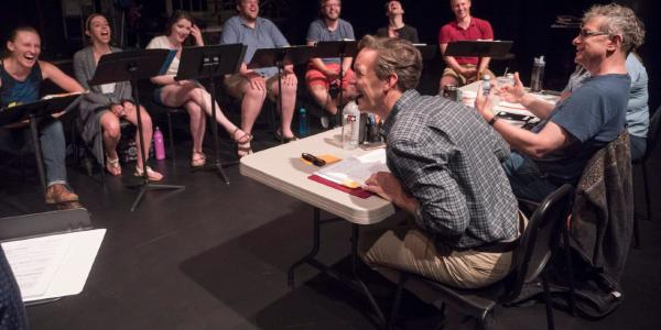 Tom Cipullo rehearses with opera performers