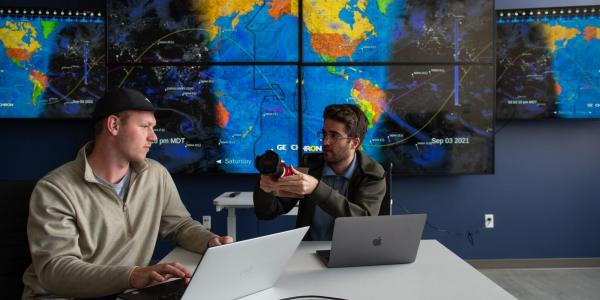 Graduate students Michael Klonowski, left, and Daniel Aguilar-Marsillach, right, work in the Raytheon Space & Intelligence Vision, Autonomy, and Decision Research (VADeR) at CU Boulder, which studies new methods for tracking and managing satellite traffic in space. (Credit: CU Boulder College of Engineering and Applied Science)
