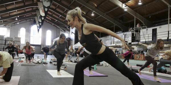 Instructor leading yoga class on campus