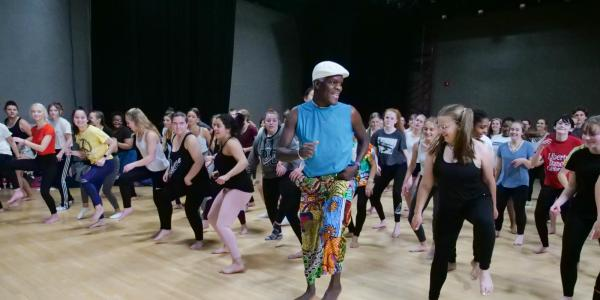 NiiAhmah Sowan leads high school students in African dance at the 2019 High School Dance Day at the CU Boulder campus. (Photo by Glenn Asakawa/University of Colorado)