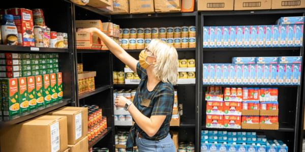 person stocking shelves with food