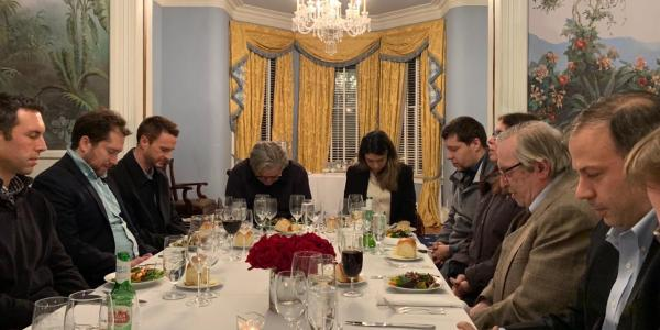 Steve Bannon and Ben Teitelbaum pray over a meal
