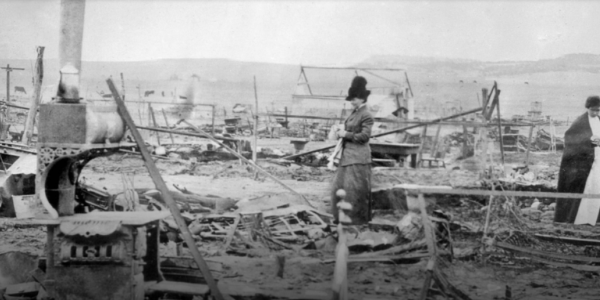 An image of the Red Cross combing the aftermath of the Ludlow Massacre. (Photo via History Colorado)