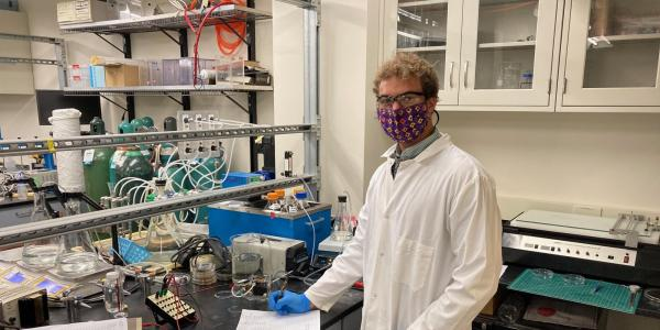 Jared Beshai conducts manual readings in a lab working on a new technique to harvest electricity from blood sugar. (Photo provided)