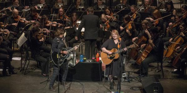 Indigo Girls performing with the CU Symphony Orchestra in Macky Auditorium