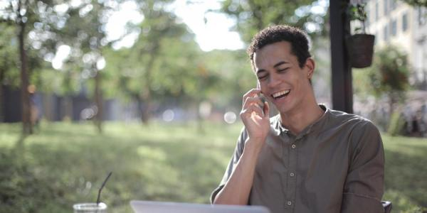 person laughing on the phone
