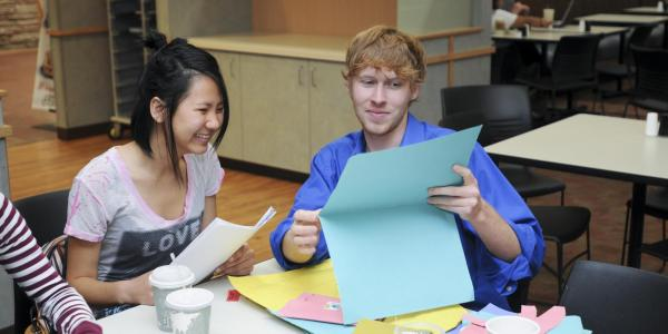 Students work on crafts at a UMC event