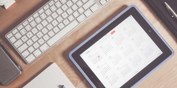 iPad with calendar app sitting on desk