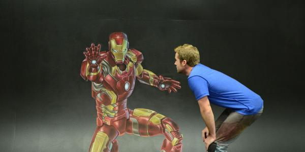 Chris Carlson and his chalk artwork of Iron Man
