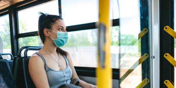 person riding bus alone