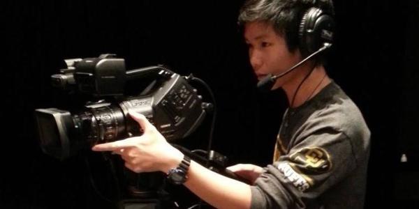 CU Boulder student Jackson Xia films for his job at CU Presents