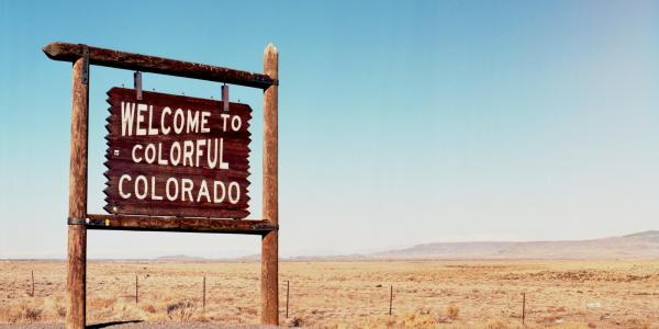 """A photo showing a """"Welcome to Colorful Colorado"""" sign (Image by Kait Herzog, via Unsplash)"""