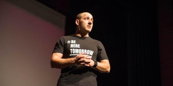 Kevin Hines speaking at an event