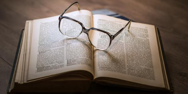 Old book with glasses on it