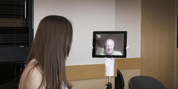 Student uses Kubi device to remotely interact in the classroom