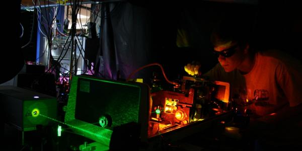 Student working on a laser in a lab at JILA