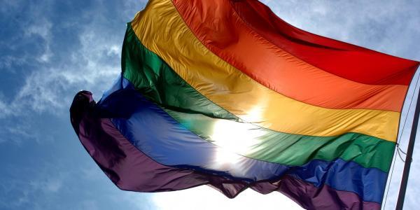 LGBTQ pride flag flying