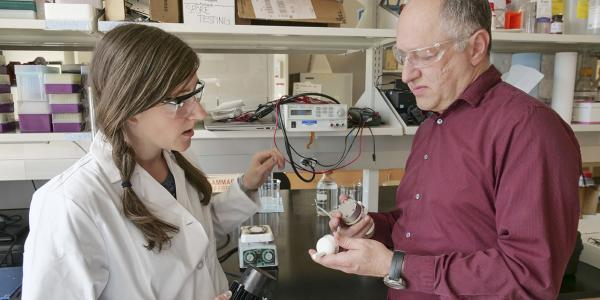 Professor Karl Linden, right, in his laboratory at CU Boulder