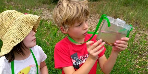 Two children taking part in a past CU Boulder-funded science event