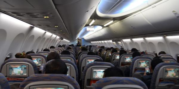 Stock image of people flying in a commercial airplane