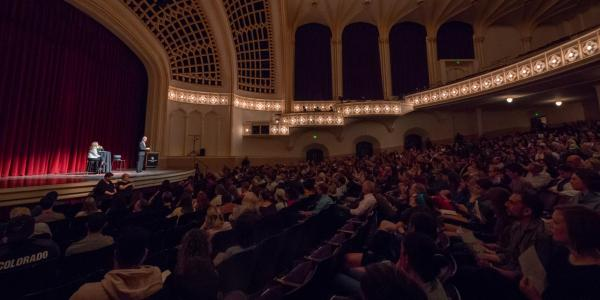 Speaker addresses crowd in Macky Auditorium