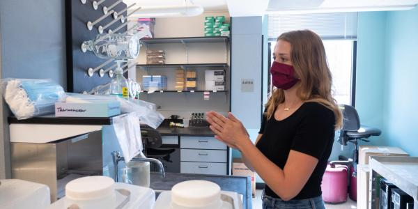 researcher works in lab on campus