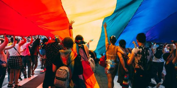 people carry giant pride flag