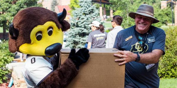 Chip and an employee help during move-in