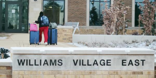 A student moves their belongings during Move-In Day on Feb. 8, 2021, at Williams Village at CU Boulder. (Photo by Casey A. Cass/University of Colorado)