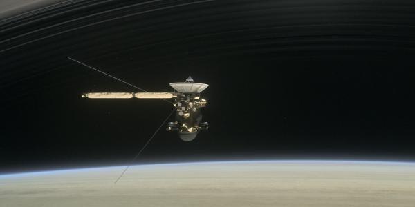 Artist's rendering of Cassini flying below Saturn's rings.