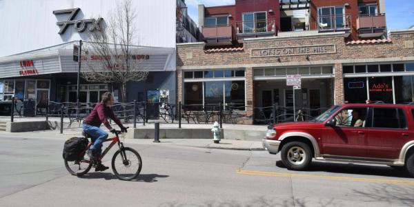person riding bike around The Hill