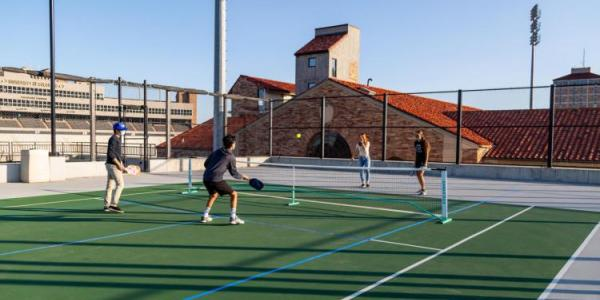 Students playing tennis.