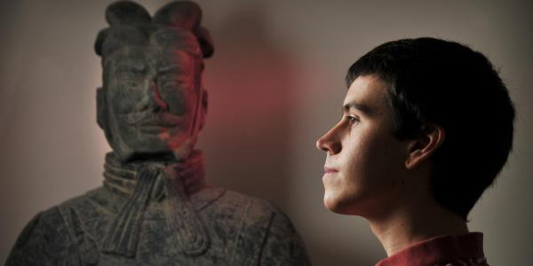 Former student Nick Bertrand with a terracotta warrior