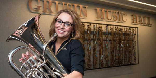 Nora Barpal poses with euphonium at Grusin Music Hall