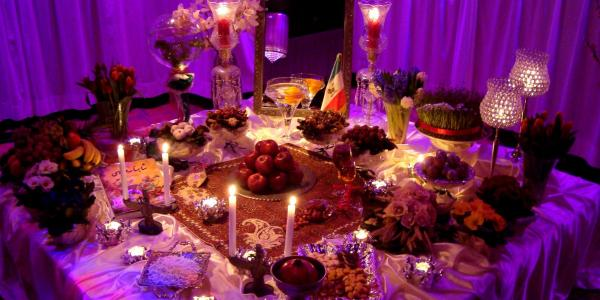 Nowruz table with foods, candles, decor