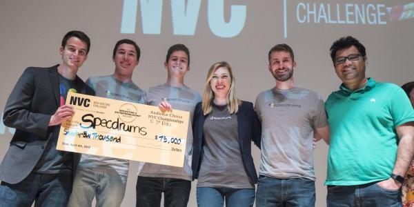 Specdrums team poses with first-place check of $75,000