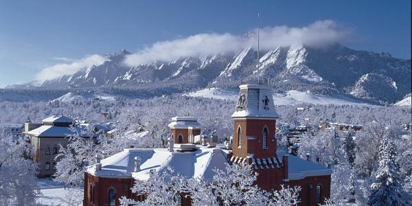 Old Main and Flatirons covered in snow