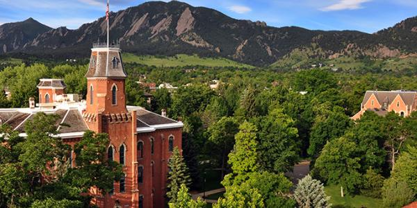 Old Main is seen against the background of the Flatirons